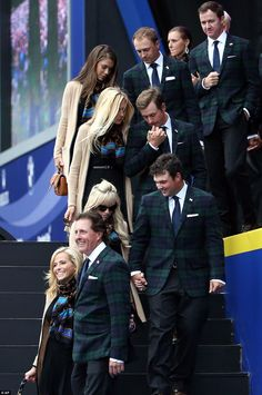 Phil Mickelson and his wife Amy, front, Patrick Reed and his wife Justine, second row, Webb Simpson and his wife Dowd, third row, and Jordan Spieth and his partner Annie Verret leave after the opening ceremony