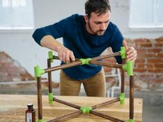 Dan Faires attaching glass base to coffee table legs