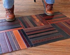 The rich, earthy look of leather wonderfully complements wood flooring. To make your own rug like this, start by designing your ideal arrangement on paper. Then proceed to cut the pieces needed and glue them down (with a strong water-based adhesive) to a sturdy backing. Almost too pretty to step on, right?