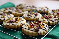 chocolate drizzled cranberry pistachio cookies from:  http://www.shebakeshere.com/2012/12/chocolate-drizzled-cranberry-pistachio.html