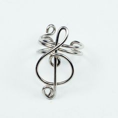Small Silver Colored Treble Clef Ear Cuff. $7.00, via Etsy.