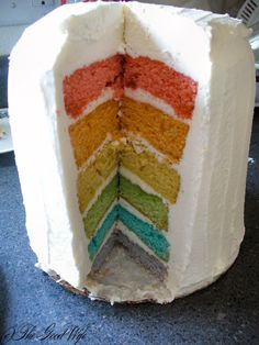 Six layer rainbow cake with vanilla buttercream and whipped cream frostings