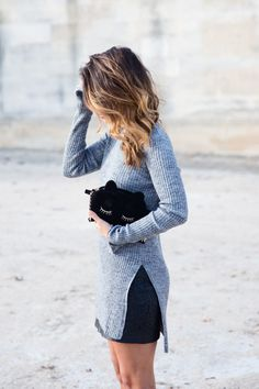 Fall fashion | Long grey sweater over skirt, black clutch