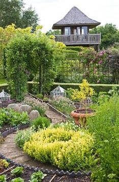 Potager Garden leading to the Knot Garden with brick pathways, rose arches with scented roses and green oak garden building - Woodpeckers, Warwickshire /gapphotos