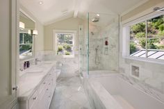 White marble bathroom with glass shower -- sumptuous and airy at the same time -- from Houzz