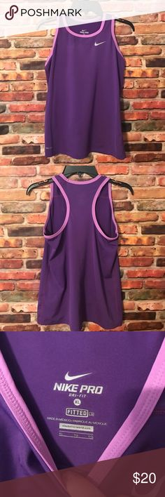 """NWOT Nike Fitted Racerback Purple Tank Top XL NWOT Nike fitted racerback tank top. Dri-Fit. Size XL. Purple tank with lavender trim at the top. Only tried on and didn't like it on me. Straps are roughly 2"""" wide. Nike Tops Tank Tops"""