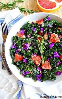 """Rosemary Infused Grapefruit and Kale """"Restaurant"""" Salad -A refreshing citrus plant based vegan salad infused with fresh rosemary and accompanied by juicy grapefruit, softened kale, hemp hearts, sunflower seeds and red cabbage. The rosemary citrus dressing pairs perfectly with this luxurious yet simple anytime salad."""