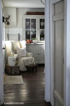 FARMHOUSE – INTERIOR – vintage early american farmhouse showcases raised panel walls, barn wood floor, exposed beamed ceiling, and a simple style for moulding and trim, like in this farmhouse. Wabi Sabi, Shabby Chic Kitchen Decor, Farmhouse Interior, Farmhouse Style, Farmhouse Door, White Farmhouse, Cool Ideas, New Room, Family Room