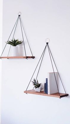 Listing is for TWO (2) Hanging Shelves with a GOLD-Plated Ring These hanging wooden shelves are just what you need if you are looking for that perfect touch of minimalist meets natural rustic decor. These shelves are customizable for your home in any wood finish or color. Hung with cord