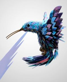 A hummingbird sculpture made from upcycled cds.  #recycling #art