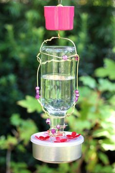 Make your own hummingbird feeder out of a used glass bottle and other household…