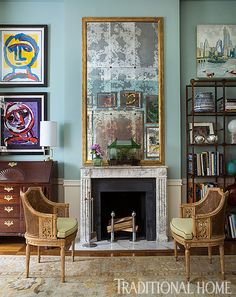 The salon-style gallery wall (reflected in the mirror above the fireplace) features a large abstract painting  along with a small still life. - Photo: John Bessler
