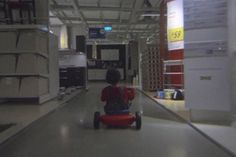 """Really cool ad from IKEA Singapore, which pays tribute to Stanley Kubrick's horror film """"The Shining."""" A child riding around the store on their tricycle, which is a nightmare in itself."""