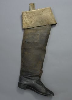 The above boot and spur were worn by John Wilkes Booth the night of April 14, 1865. Booth arrived at Dr. Samuel Mudd's house early the next morning in need of medical care for an injured leg. Mudd cut the boot and removed it from Booth's swollen ankle. Five days later investigators arrived at Mudd's house and found the boot.