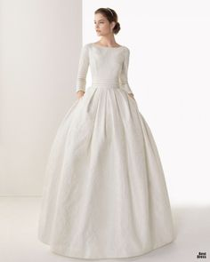 This! If I could have designed my wedding dress 10 years ago, it would have been identical to this, except with half-length tulip sleeves.