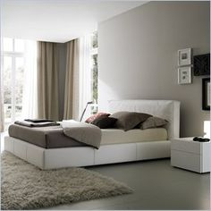 Rossetto Touch Platform Bed in White - The touch bed is completely covered in leather effect making the sleeping area personal and sophisticated. The soft headboard transmit a sensation of pure comfort and relaxation. Features: Warranty: 1 Year manufacture defect Finish: White Leather effect Made in Italy Bed consists of headboard, ring, and slat.