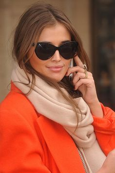 love the orange colour coat and her hair colour