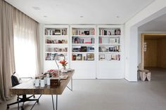 These built-in bookshelves double as hidden doors and open to reveal a secret living room.