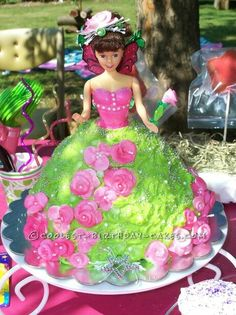 Coolest Garden Fairy Cake... This website is the Pinterest of birthday cake ideas