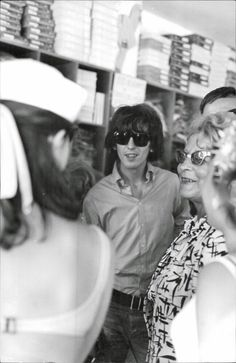George Harrison out shopping during a break in filming the bands second film, Help! 1965. ((This photo goes along with the ones of Paul McCartney))