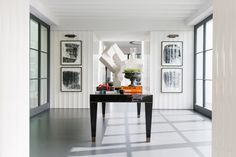 Gorgeous antiques, vintage finds and cutting edge pieces from some of today's biggest design talents combine in the recently completed Beverly Hills home of fashion entrepreneur and s...