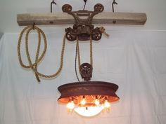 Another cool light fixture.  Etsy listing at https://www.etsy.com/listing/178617396/hay-trolley-hanging-light-fixture