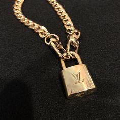 Authentic Louis Vuitton lock attached to a 24 inch curb link chain necklace. Chain is not Louis Vuitton but a high quality gold tone chain. Necklace opens and closes with either clasp attached to the lock. Lock has been polished. Cute Jewelry, Jewelry Gifts, Silver Jewelry, Jewelry Accessories, Jewelry Necklaces, Silver Ring, Gold Jewellery, Diamond Jewelry, Tanishq Jewellery