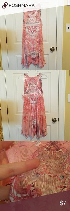 Tank top tunic, large, pink Large pink and white tank top/tunic with a swingy handkerchief style bottom. Small gap in back mesh (see pic). Simply Couture Tops Tank Tops