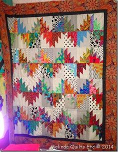 Scrappy Mountains Majesties-- Pattern from Bonnie Hunter.  Plan:  Use R/W/B jelly roll strips with lights from stash.