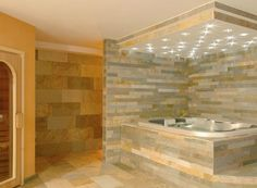 Interior hot tub with natural slate wall and floor tiles. Contact sales@solusceramics.com for details.