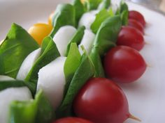 Delicious tomato, mozzarella & basil skewers. So easy to make & delicious. Drizzle with olive oil, sprinkle with salt & pepper & serve.