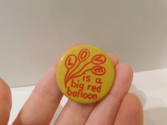 Vintage Red and Yellow Pin Pinback Button That Reads Love is a Big Red Balloon DR17