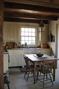 I'm so glad that I have beams in my kitchen like this. Wonderful Eat-in Kitchen | Content in a Cottage