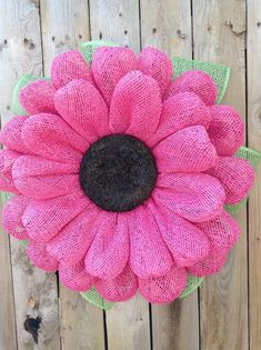 "This Pink Burlap Daisy Wreath is made using water resistant poly burlap mesh, with a Black wood chip center and Measures 21"" in diameter (with leaves) or 18 without, 4"" in depth and will fit between your front door and storm door. This Wreath is bright, cheery and would look great on any door! Each"