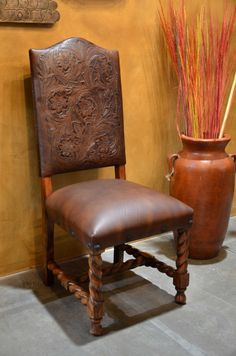 Hand carved, twisted designs paired with hand-tooled leather complete this Spanish, Silla Chapital chair.