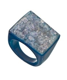 Accessorize with fabulous accessories like the Dara blue all geode ring and make your presence known. The rocky ring top issimply stunning. The ring is made in Brazil and hand crafted from onesingle piece of agate geode. $88.00 by Max & Chloe