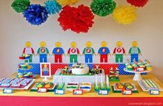 Lego Birthday Decorations-primary tissue paper poms super easy to make and inexpensive. Nice balloon alternative.