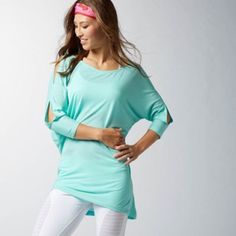 Reebok Dance Shrug It Off Cold Shoulder Aqua Top Reebok Shrug It Off cold shoulder top in Crystal Blue -- a beautiful turquoise aqua. Size small, but can also fit a medium, due to the relaxed, draped silhouette. New without tag. No flaws. Longer length. Ideal for layering.  Super soft material. 3/4 dolman sleeves. Perfect for dance, yoga, tennis or fun, casual days. Smoke-free home. No trades. Offers welcome! Reebok Tops Tunics