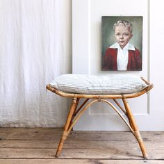 Vintage Bamboo Ottoman / Ethan Ollie Love placing pictures low like this.