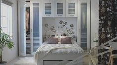 "Surround a bed with wardrobes and cabinets to frame the bed and add some storage - then add a wall decal above the bed as the ""headboard""."