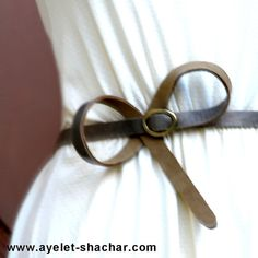 Make a bow when you have a longer belt.