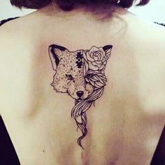 Incredible black ink fox tattoo on upper back stylized with rose flower