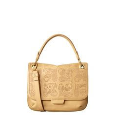 Orla Kiely: Leather bag with giant punched acorn detailing and magnetic fastening to close. Includes detachable strap so that the bag can be worn across the body and large back pocket to back. With three internal compartments. Inside details include a small zip pocket, key chain and mobile pocket.