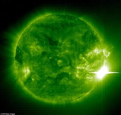 This 04 November, 2003 image shows giant sunspot 486 (lower-R) 486 unleashing another powe...