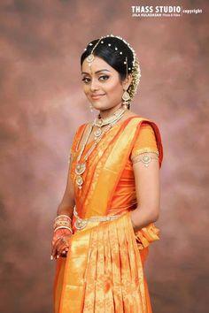 Stunning South Indian Bride in a Bright Orange Silk Saree