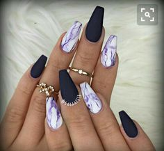 I LOVE THIS! The colors, not the pointy ends of the nails!! Although... I'm thinking a dark blue in place of the purple...