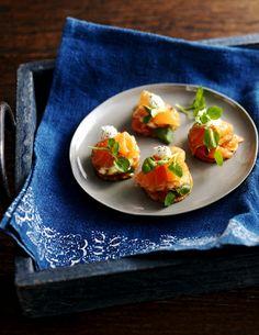 Crisp potato slices topped with smoked salmon and homemade horseradish cream make a tasty canapé.