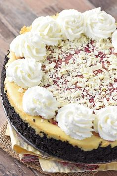 Make Olive Garden's white chocolate raspberry cheesecake at home. Who doesn't love a decadent homemade dessert with a raspberry swirl and Oreo cookie crust? #flouronmyfingers #cheesecake #OliveGarden #copycatrecipes #dessertrecipes