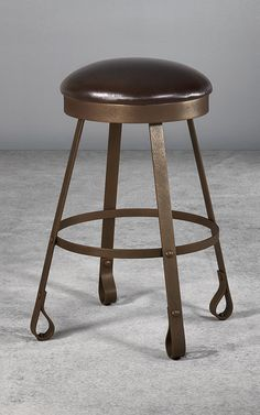 Expertly styled, the Everton bar stool captures the imagination with fine craftsmanship that evokes images of jousting knights, Old World pubs and an era of elegant ironwork. Everton features distinctive detailing with well-placed rivets and a sexy curvature of the iron to create a functional yet stylish foot that's both unexpected and the perfect punctuation for this unique piece of designer iron furniture.