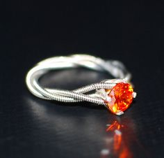 Catching Fire Hunger Games Guitar String Engagement Ring Triple by dremeWORKS, $50.00 Great ring for all you Hunger Games fanatics out there!